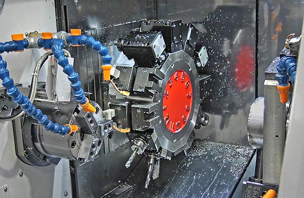 Lathe makes prismatic and pressed parts
